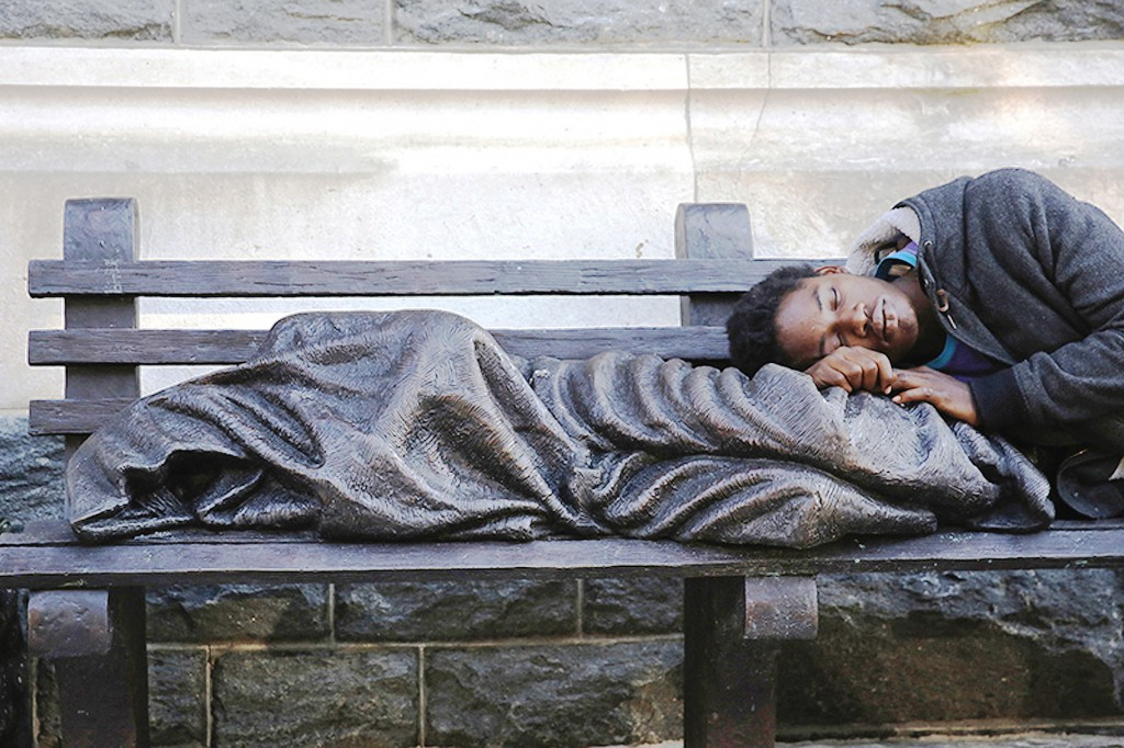 Homeless Jesus in Washington DC with homeless man Photos courtesy of the Methodist Central Hall press pack. All copyright Timothy P Schmalz.